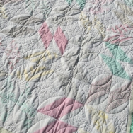Diamond half square triangles with custom quilting loops and curves