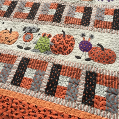 Custom quilting on halloween martian quilt