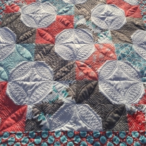 Spool quilt with custom orange peel quilting