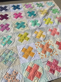 My raspberry kiss swap quilt with custom quilting