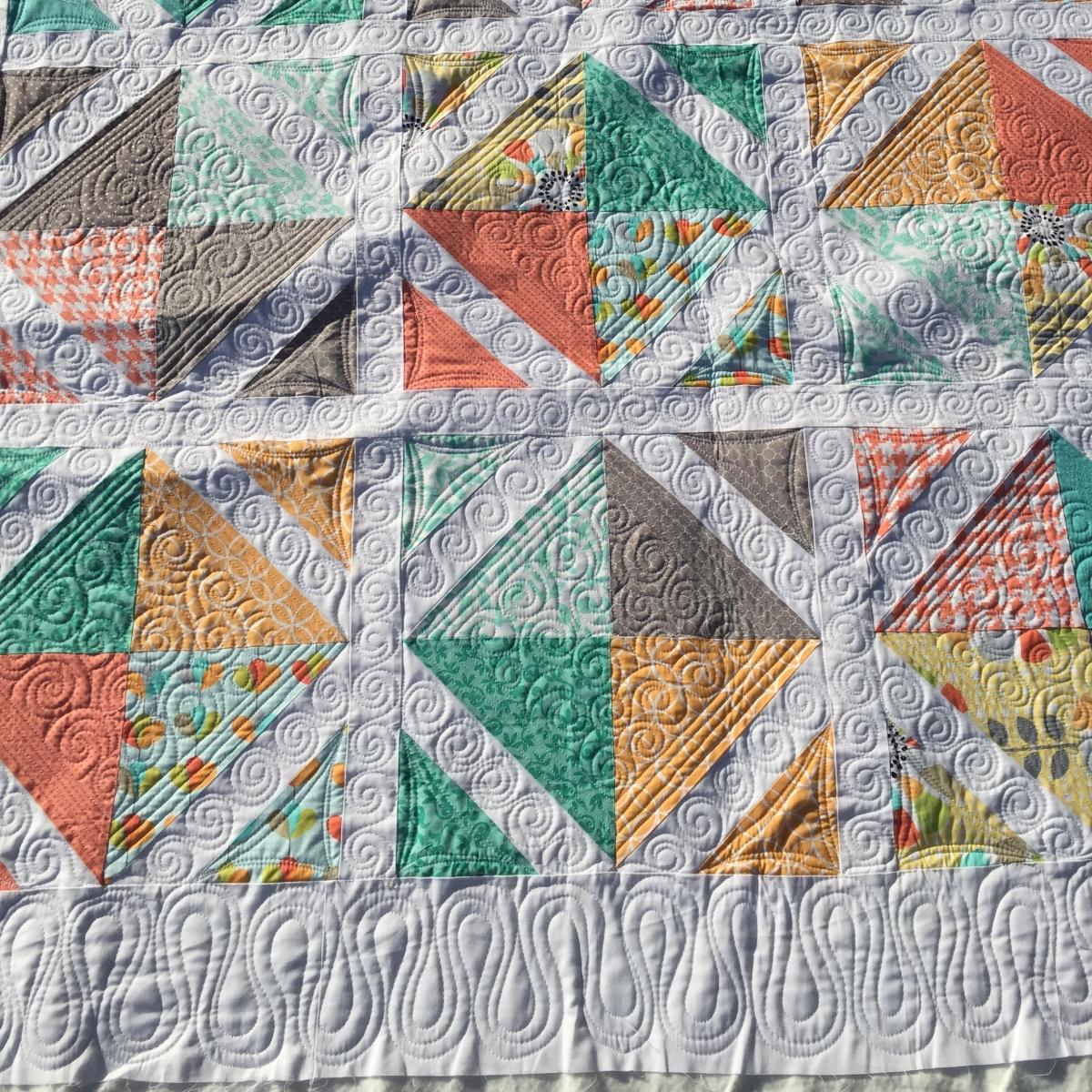 Lattice quilt with swirly custom quilting