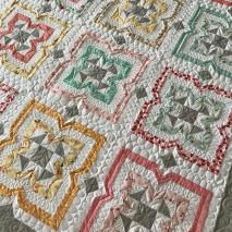 Custom quilting on desert rose quilt by kate spain