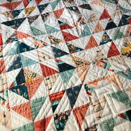 Half Square triangle quilt; art gallery southwest fabric