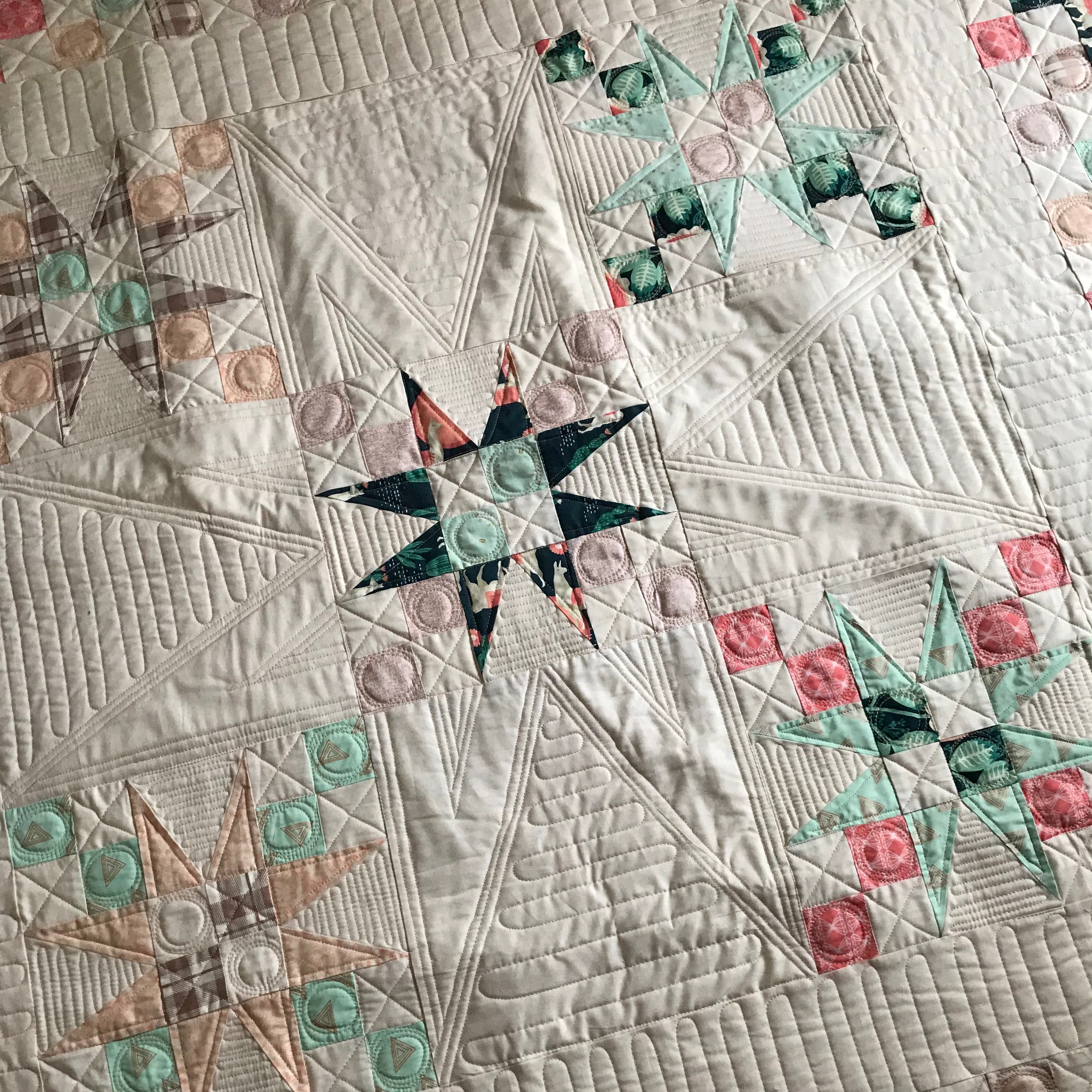 Pointed star quilt with custom quilting