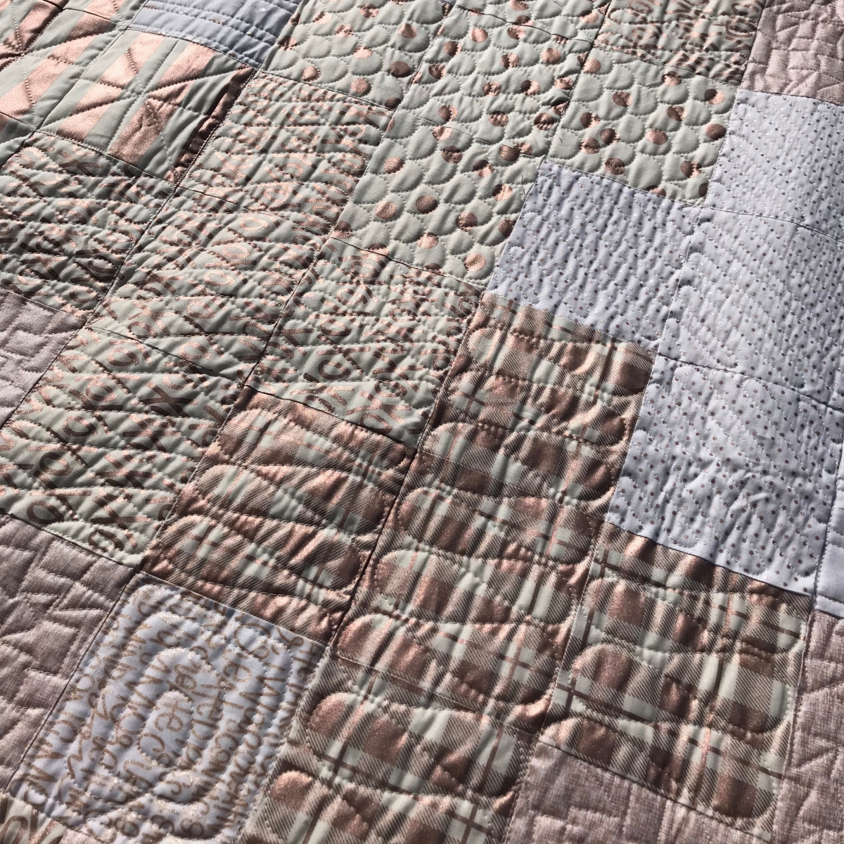 Rose Gold Plus Quilt with custom quilting
