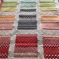 Thimble Blossoms basics jelly roll quilt; square quilt with sash