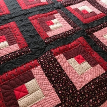 Red and Black Logan Cabin Quilt with custom quilting