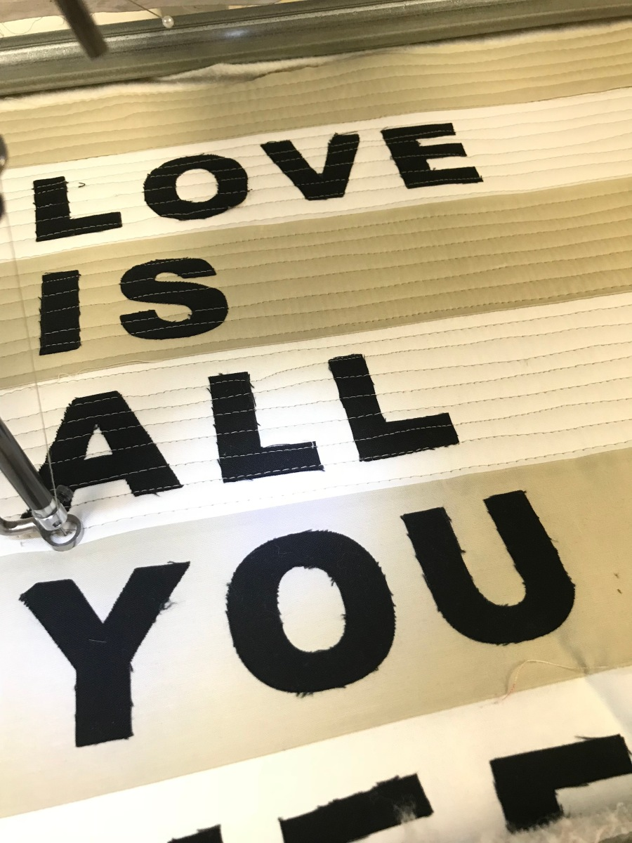 Machine Quilting on Front of Love is All You Need Pillow