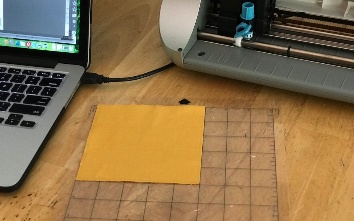 cutting fabric with silhouette load fabric on mat