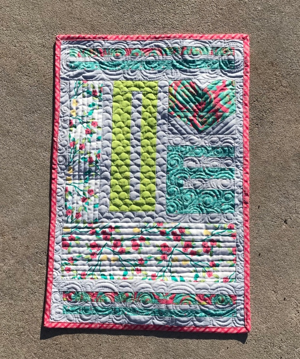 show love quilt; custom quilting; feather quilting; clam shell quilting; swirl quilting'