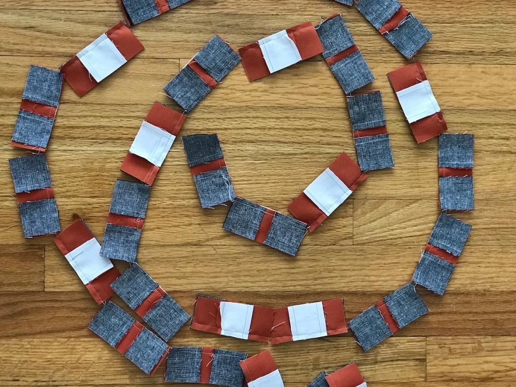 Chain piecing spiral golden slumbers quilt