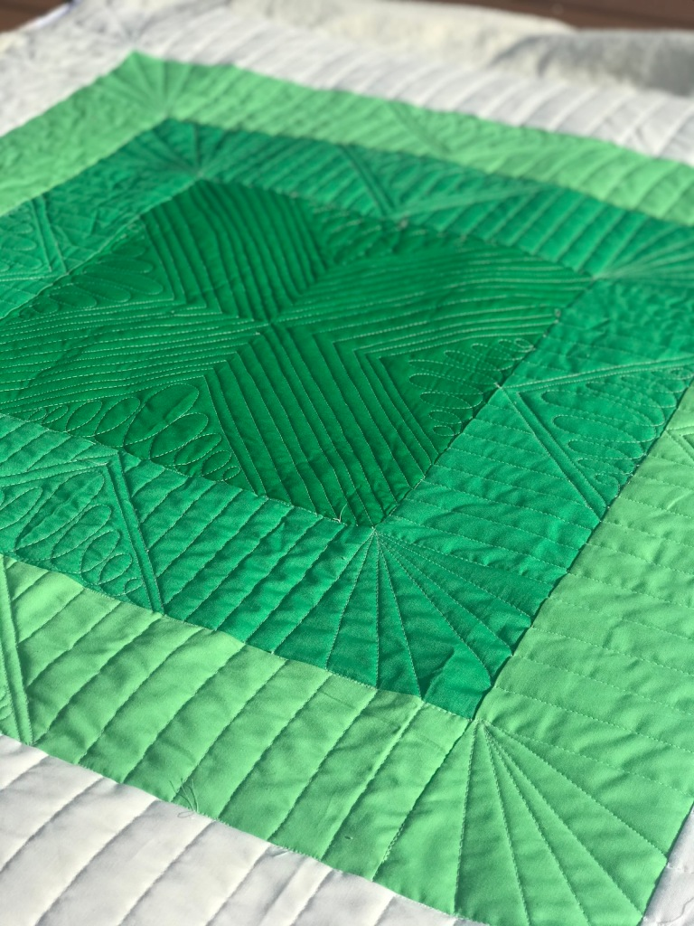 green initial k studio squared quilt; modern baby quilt; ombre quilt; custom longarm quilting; Molly Kohler