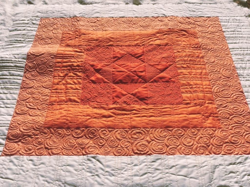 Squared Quilt; Initial K Studios, custom longarm quilt by Molly Kohler; orange quilt; modern baby quilt