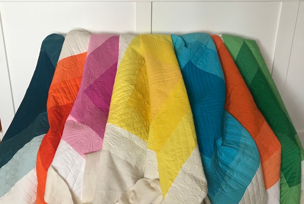 Initial K Studio Squared Quilt; custom quilting; modern baby quilts; rainbow colors; ombre
