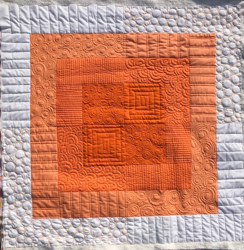 Initial K Squared Quilt; custom longarm quilting by Molly Kohler; modern baby quilt; orange quilt; ombre quilt;