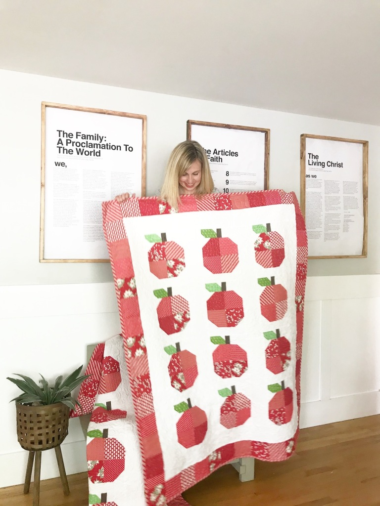 Molly Kohler holding sweet apple quilt block quilt; free printable pattern